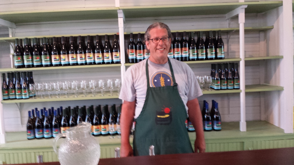 Stephen Graue tending the tasting bar at the New Lancaster General Store & Winery. Photo Credit: Kristin Graue